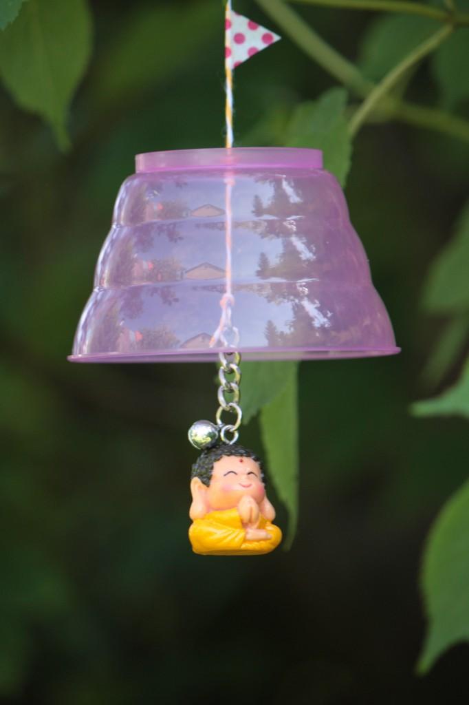 Kleiner Buddha mit Regendach